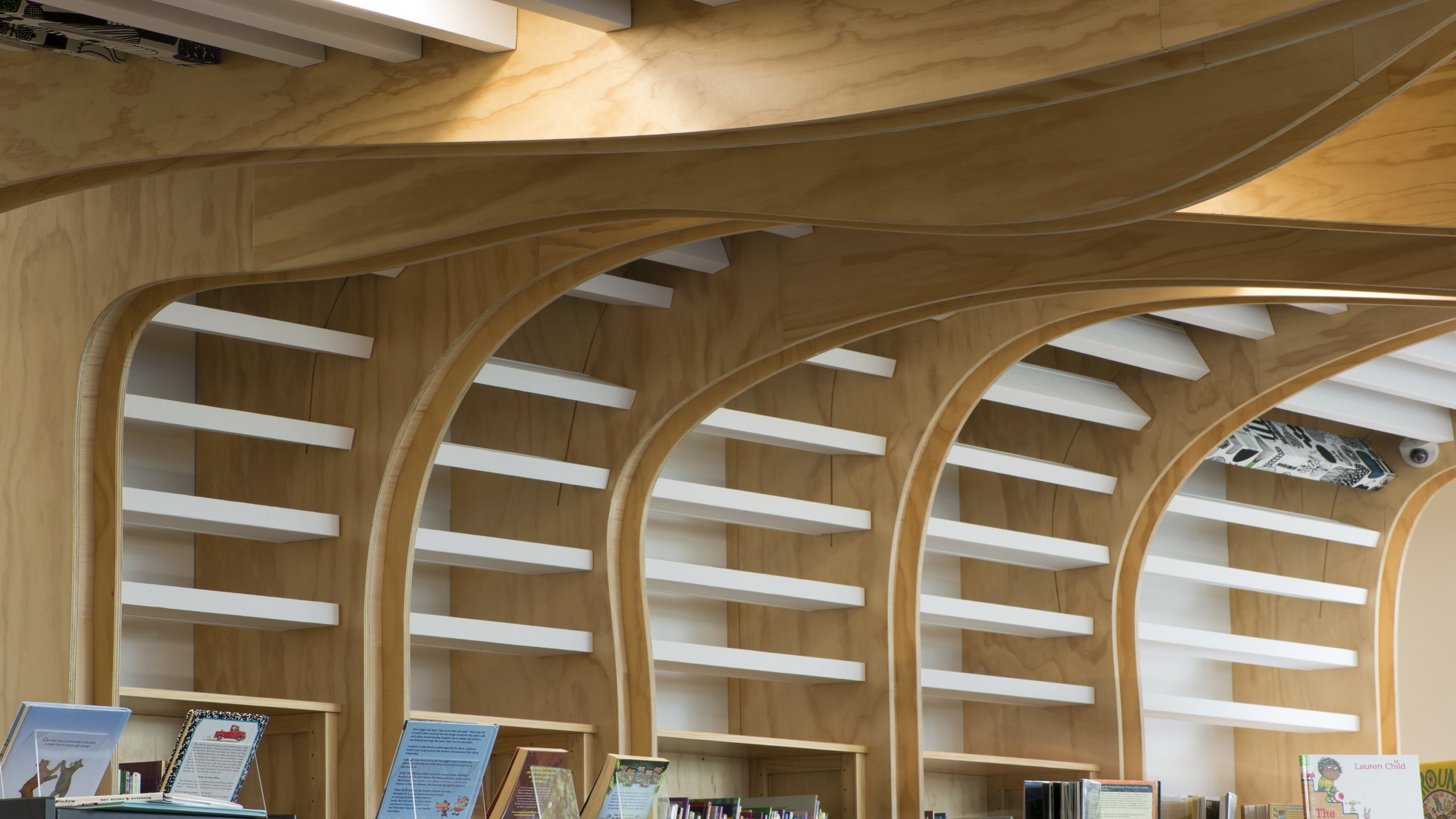 Devonport Library showing white baffle beams installed onto an undulating ceiling feature