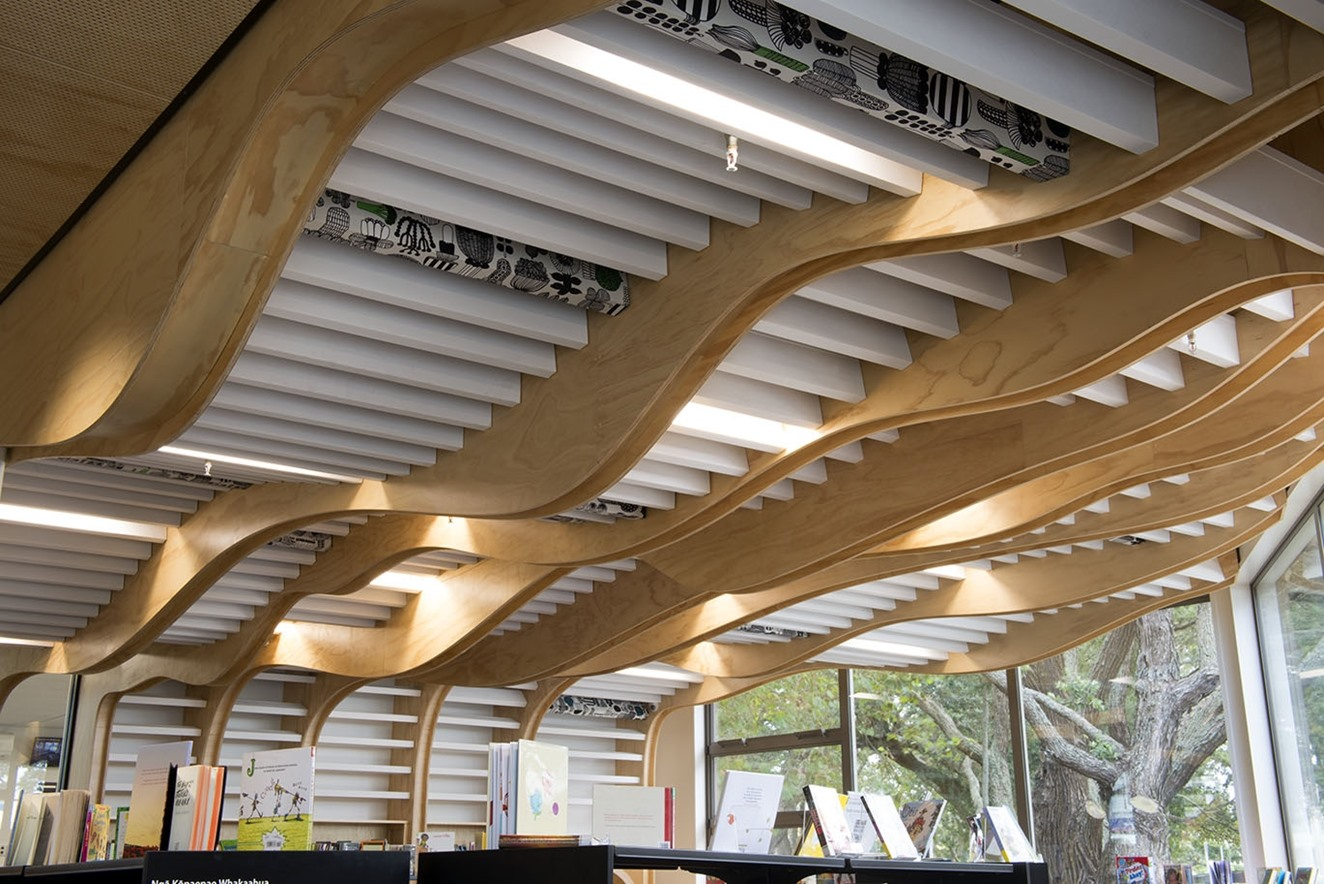 Devonport Library showing rows of white Baffle Beams installed to undulating ceiling