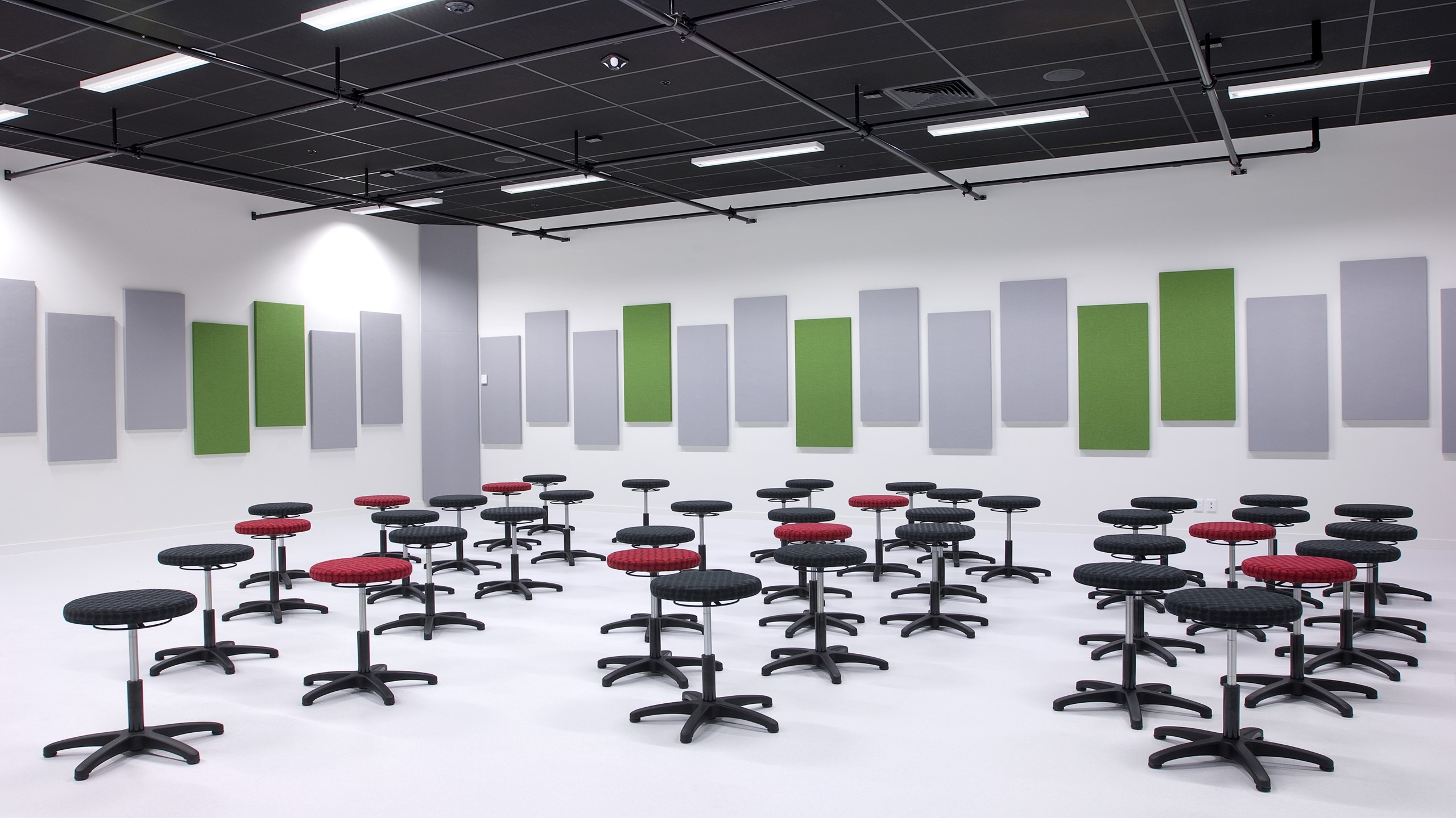 Hobsonville Point Intermediate Music Room showing direct fixed rectangular Fabwall panels wrapped in grey and green fabrics