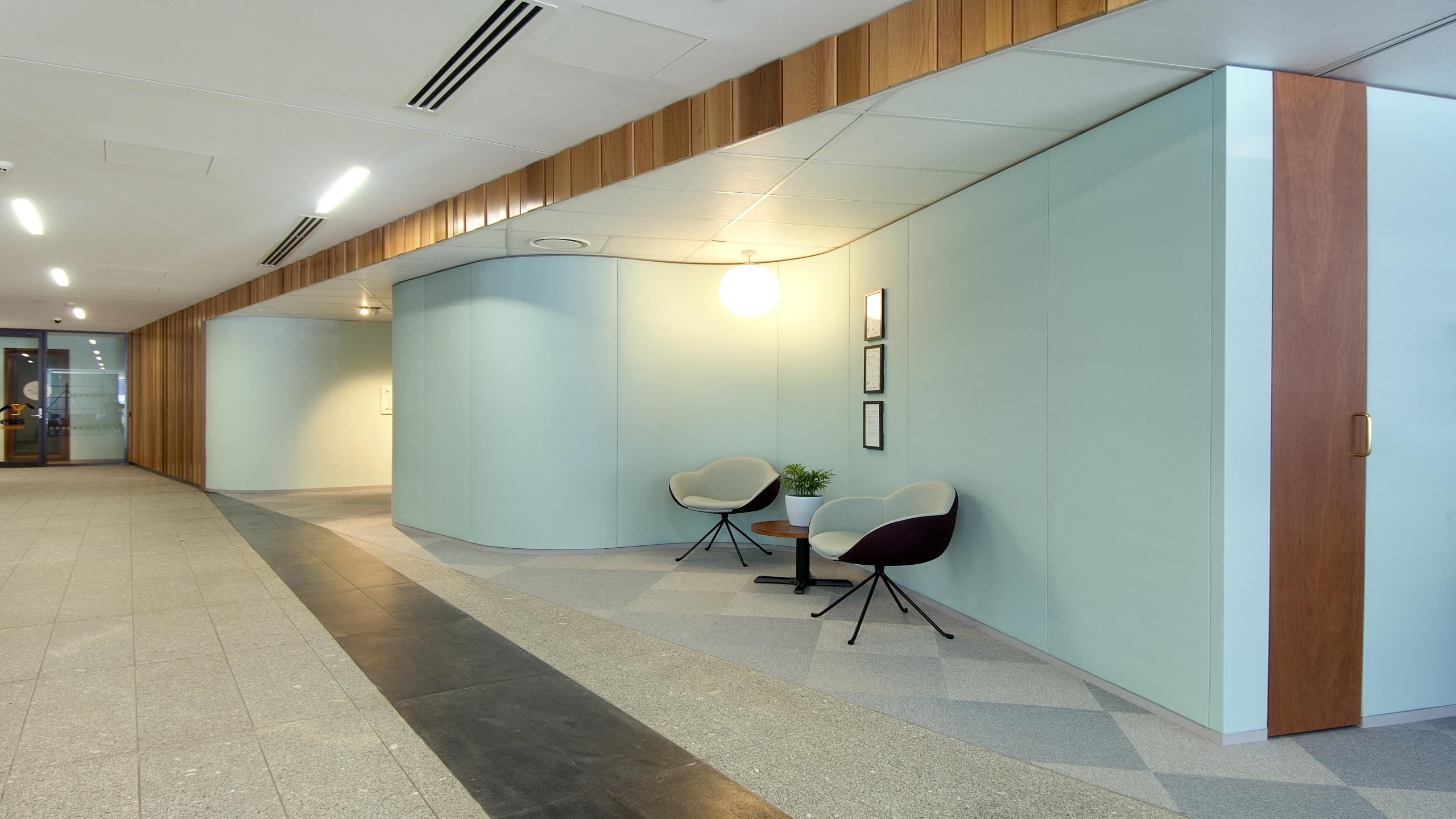 Genesis HQ showing Snaptex installed to flowing curved walls in aqua digitally printed fabric