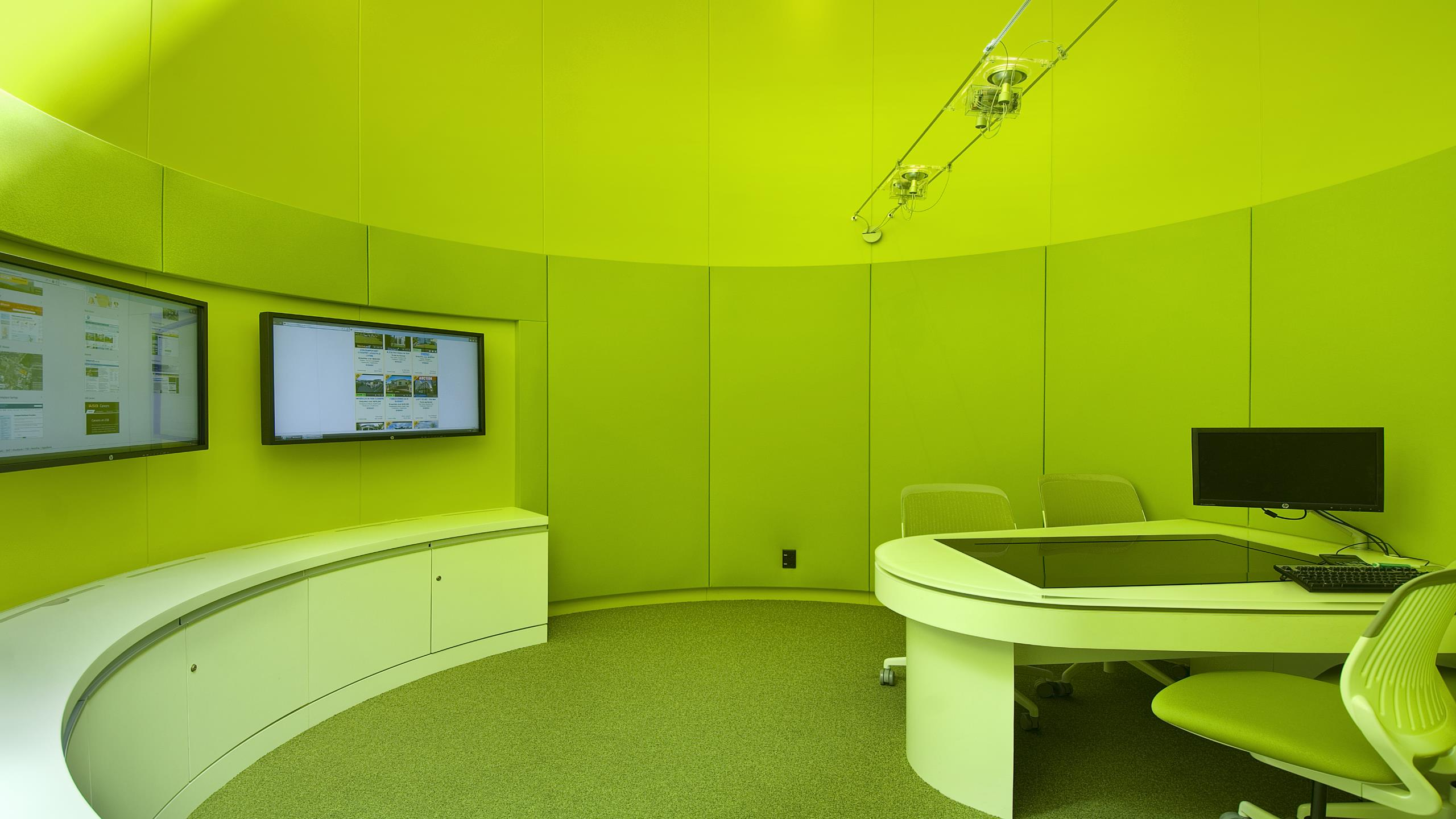 ASB North Wharf HQ showing installed curved Snaptex paneled media rooms in lime coloured fabric