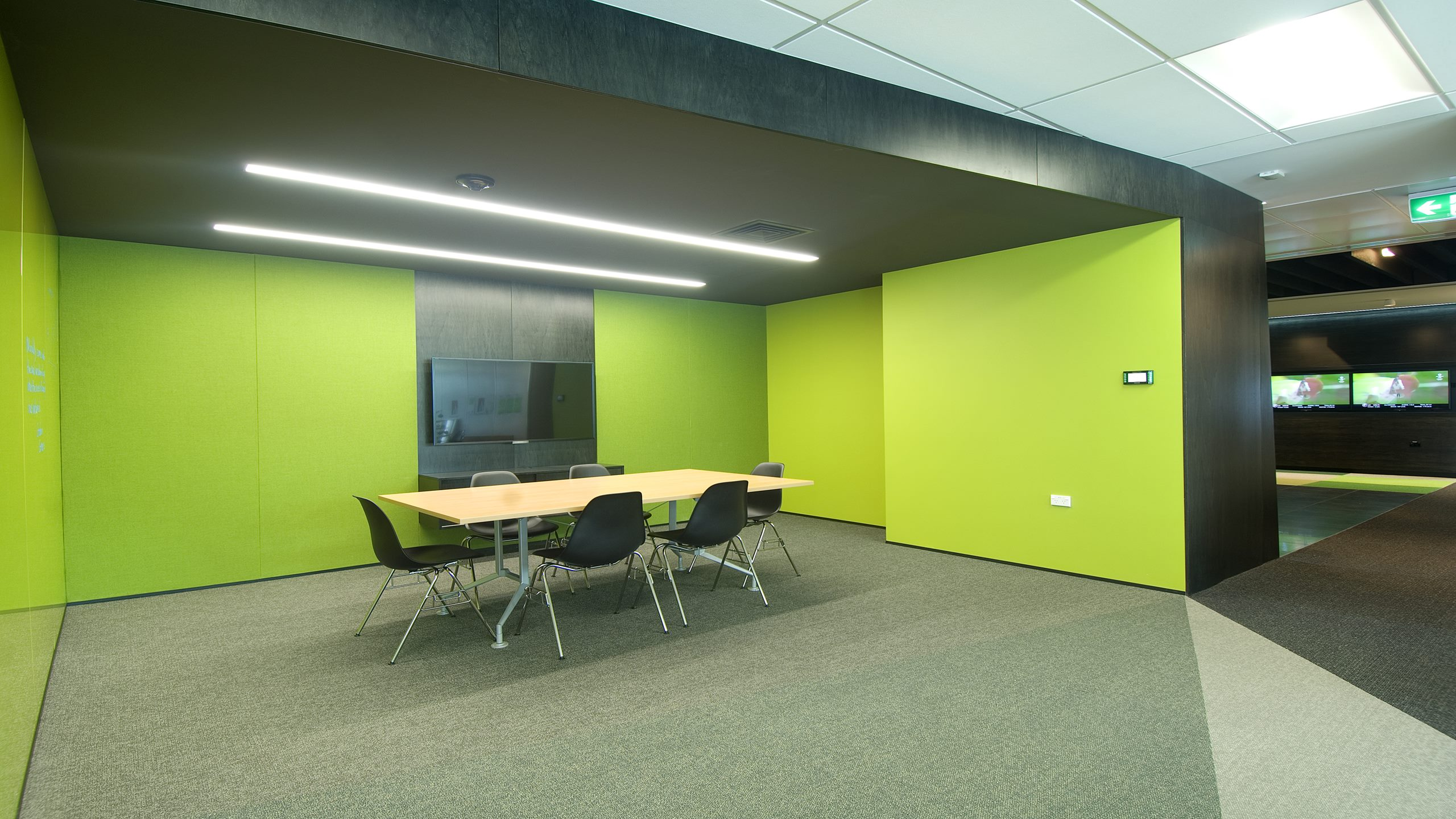 Premier Pinboard in green fabric installed in an open plan meeting area.